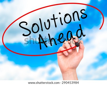 Man Hand writing Solutions Ahead with black marker on visual screen. Isolated on sky. Learn, technology, internet concept. Stock Image - stock photo