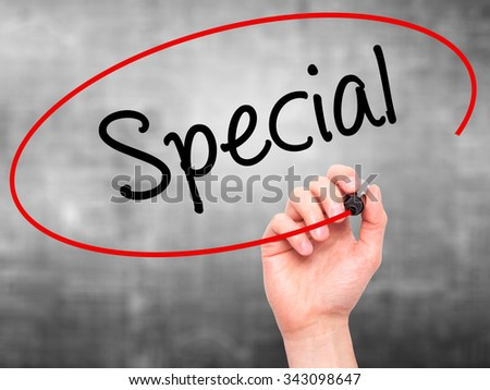 Man Hand writing Special with black marker on visual screen. Isolated on grey. Business, technology, internet concept. Stock Photo