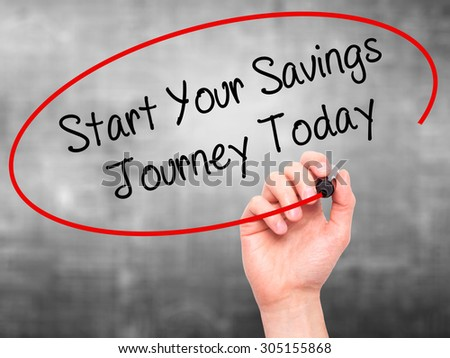 Man Hand writing Start Your Savings Journey Today with black marker on visual screen. Isolated on grey. Business, technology, internet concept. Stock Photo