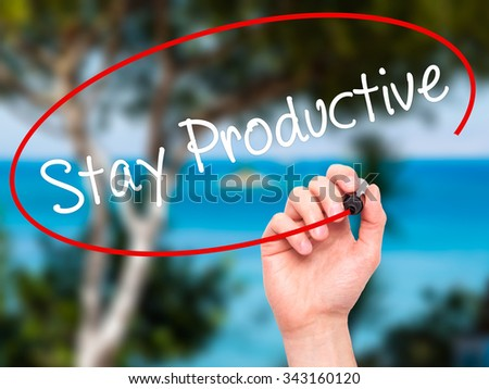 Man Hand writing Stay Productive with black marker on visual screen. Isolated on nature. Business, technology, internet concept. Stock Photo - stock photo