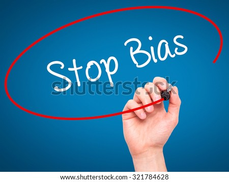 Man Hand writing Stop Bias with black marker on visual screen. Isolated on blue. Business, technology, internet concept.  - stock photo