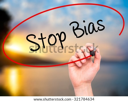 Man Hand writing Stop Bias with black marker on visual screen. Isolated on nature. Business, technology, internet concept.  - stock photo
