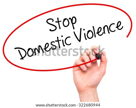 Man Hand writing  Stop Domestic Violence with black marker on visual screen. Isolated on white. Business, technology, internet concept. Stock Photo - stock photo