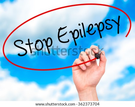 Man Hand writing  Stop Epilepsy with black marker on visual screen. Isolated on background. Business, technology, internet concept. Stock Photo - stock photo
