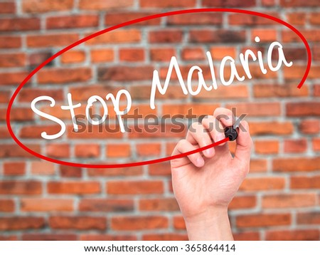 Man Hand writing Stop Malaria  with black marker on visual screen. Isolated on background. Business, technology, internet concept. Stock Photo - stock photo