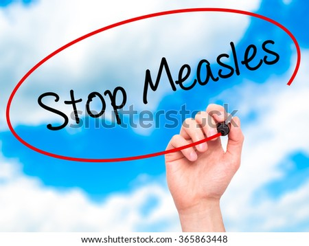 Man Hand writing Stop Measles  with black marker on visual screen. Isolated on background. Business, technology, internet concept. Stock Photo - stock photo