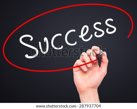Man Hand writing Success with black marker on visual screen. Isolated on black. Business, technology, internet concept. Stock Image - stock photo