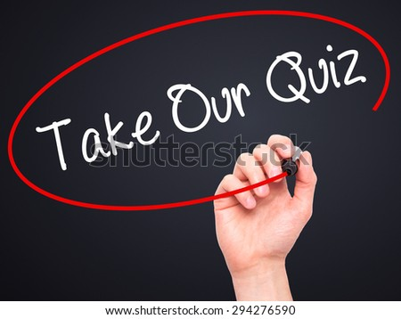 Man Hand writing Take Our Quiz with black marker on visual screen. Isolated on black. Business, technology, internet concept. Stock Photo - stock photo