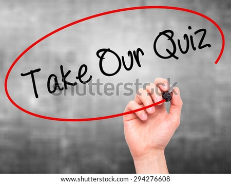 Man Hand writing Take Our Quiz with black marker on visual screen. Isolated on grey. Business, technology, internet concept. Stock Photo - stock photo