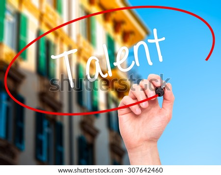 Man Hand writing Talent  with black marker on visual screen. Isolated on city. Business, technology, internet concept. Stock Photo - stock photo
