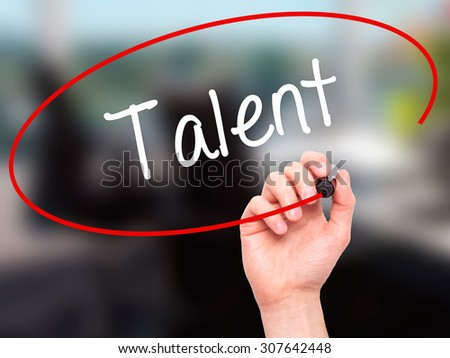 Man Hand writing Talent  with black marker on visual screen. Isolated on office. Business, technology, internet concept. Stock Photo - stock photo