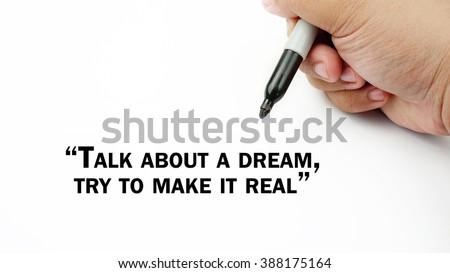 "Man Hand writing ""talk about a dream,try to make it real"" with black marker on visual screen. Isolated white background. Business, technology, internet concept. Stock Photo"