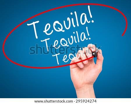 Man Hand writing Tequila with black marker on visual screen. Isolated on blue. Business, technology, internet concept. Stock Photo - stock photo
