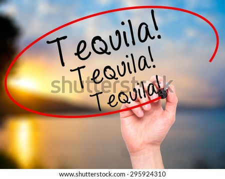 Man Hand writing Tequila with black marker on visual screen. Isolated on nature. Business, technology, internet concept. Stock Photo - stock photo