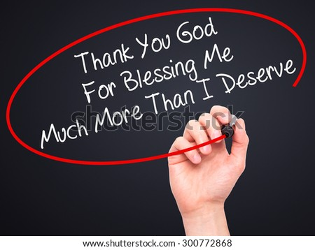 Man Hand writing Thank You God For Blessing Me Much More Than I Deserve with black marker on visual screen. Isolated on black. Business, technology, internet concept. Stock Photo