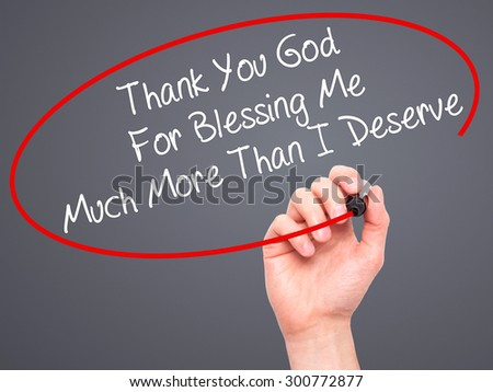Man Hand writing Thank You God For Blessing Me Much More Than I Deserve with black marker on visual screen. Isolated on grey. Business, technology, internet concept. Stock Photo