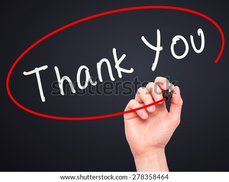 Man Hand writing Thank You with marker on transparent wipe board. Isolated on black. Business, internet, technology concept.  Stock Photo - stock photo