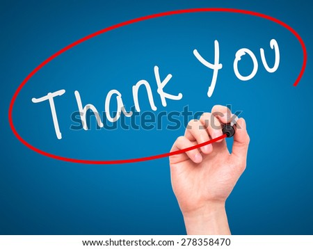 Man Hand writing Thank You with marker on transparent wipe board. Isolated on blue. Business, internet, technology concept.  Stock Photo - stock photo