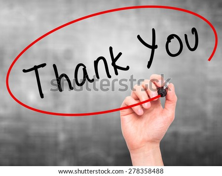 Man Hand writing Thank You with marker on transparent wipe board. Isolated on grey. Business, internet, technology concept.  Stock Photo - stock photo