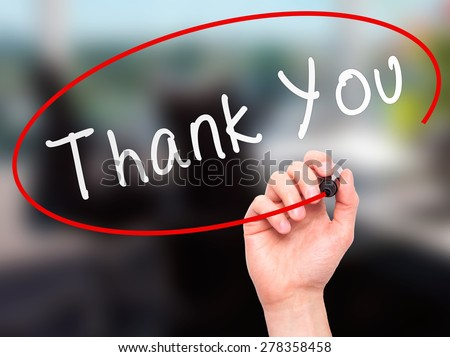Man Hand writing Thank You with marker on transparent wipe board. Isolated on office. Business, internet, technology concept.  Stock Photo - stock photo