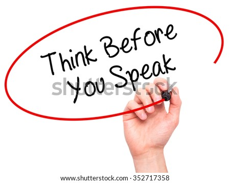 Man Hand writing Think Before You Speak with black marker on visual screen. Isolated on background. Business, technology, internet concept. Stock Photo - stock photo