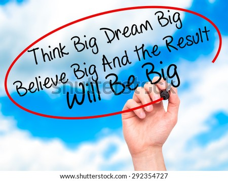 Man Hand writing Think Big Dream Big Believe Big And the Result Will Be Big with black marker on visual screen. Isolated on sky. Business, technology, internet concept. Stock Image