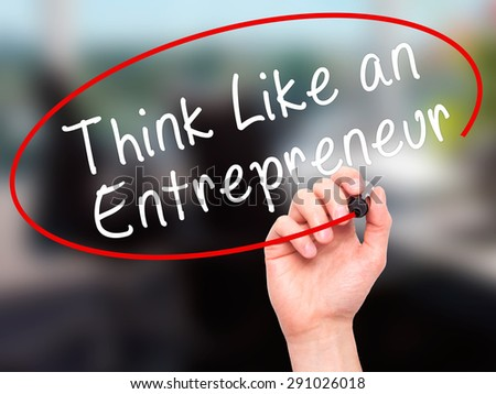 Man Hand writing Think Like an Entrepreneur with black marker on visual screen. Isolated on office. Business, technology, internet concept. Stock Image - stock photo