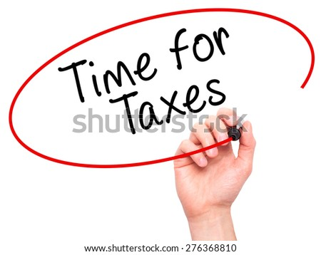 Man Hand writing Time for Taxes with marker on transparent wipe board. Isolated on white. Business, internet, technology concept.  Stock Photo - stock photo
