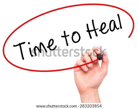 Man Hand writing Time to Heal with marker on transparent wipe board. Isolated on white. Business, internet, technology concept. Stock Photo - stock photo