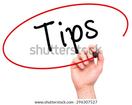 Man Hand writing Tips with black marker on visual screen. Isolated on white. Business, technology, internet concept. Stock Photo