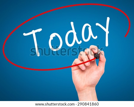 Man Hand writing Today with black marker on visual screen. Isolated on blue. Business, technology, internet concept. Stock Image - stock photo