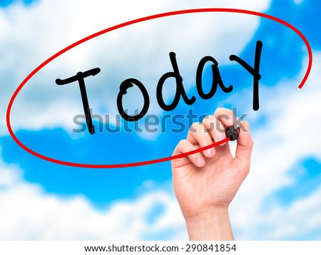 Man Hand writing Today with black marker on visual screen. Isolated on sky. Business, technology, internet concept. Stock Image - stock photo