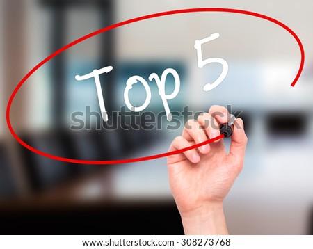 Man Hand writing Top 5 with black marker on visual screen. Isolated on office. Business, technology, internet concept. Stock Photo - stock photo