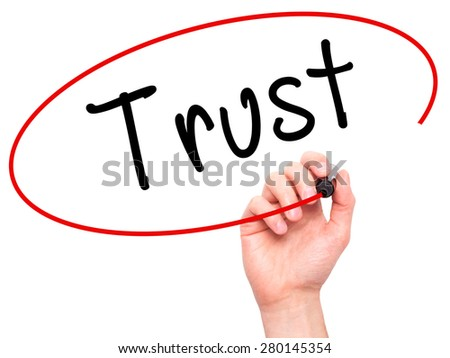 Man Hand writing Trust black marker on visual screen. Isolated on white. Business, technology, internet concept. Stock Image - stock photo
