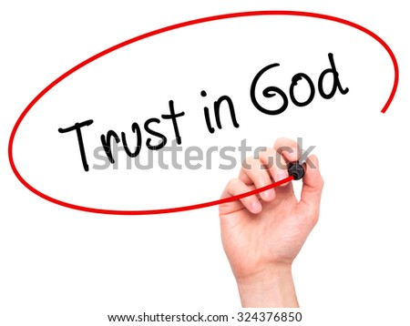 Man Hand writing Trust in God with black marker on visual screen. Isolated on white. Business, technology, internet concept. Stock Photo - stock photo