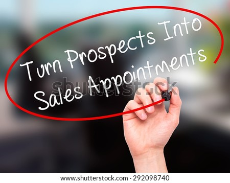 Man Hand writing Turn Prospects Into Sales Appointments  with black marker on visual screen. Isolated on office. Business, technology, internet concept. Stock Image - stock photo