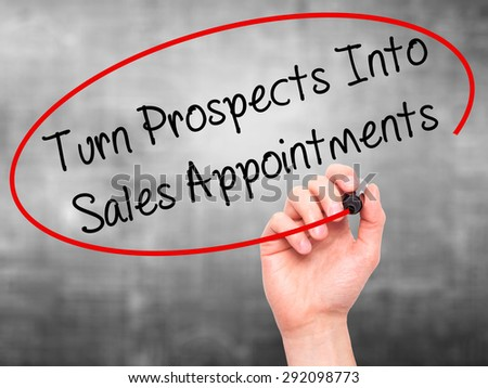 Man Hand writing Turn Prospects Into Sales Appointments  with black marker on visual screen. Isolated on grey. Business, technology, internet concept. Stock Image