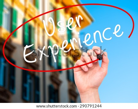 Man Hand writing User Experience with black marker on visual screen. Isolated on city. Business, technology, internet concept. Stock Image - stock photo