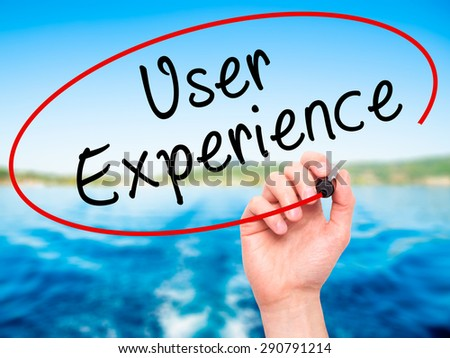 Man Hand writing User Experience with black marker on visual screen. Isolated on nature. Business, technology, internet concept. Stock Image - stock photo