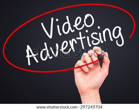 Man Hand writing Video Advertising with black marker on visual screen. Isolated on black. Business, technology, internet concept. Stock Photo - stock photo
