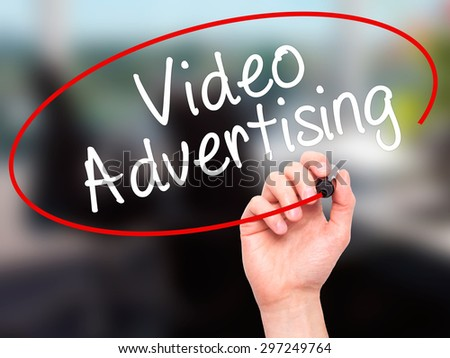 Man Hand writing Video Advertising with black marker on visual screen. Isolated on office. Business, technology, internet concept. Stock Photo - stock photo
