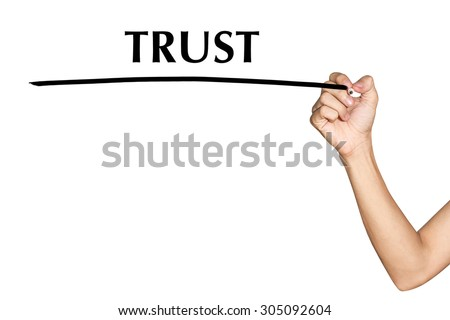 Man hand writing virtual screen text TRUST on white background - stock photo