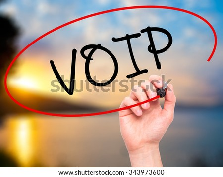 Man Hand writing VOIP with black marker on visual screen. Isolated on background. Business, technology, internet concept. Stock Photo - stock photo