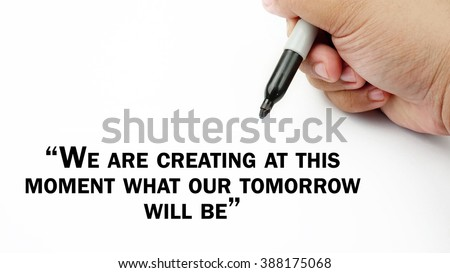 "Man Hand writing ""we are creating at this moment what our tomorrow will be"" with black marker on visual screen. Isolated white background. Business, technology, internet concept. Stock Photo"