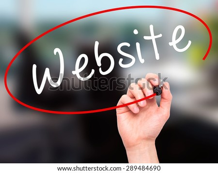 Man Hand writing Website with black marker on visual screen. Isolated on office. Business, technology, internet concept. Stock Image - stock photo