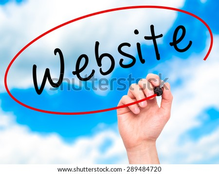 Man Hand writing Website with black marker on visual screen. Isolated on sky. Business, technology, internet concept. Stock Image - stock photo