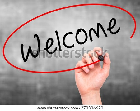 Man Hand writing Welcome with marker on transparent wipe board. Isolated on grey. Business, internet, technology concept. Stock Photo - stock photo