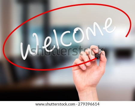 Man Hand writing Welcome with marker on transparent wipe board. Isolated on office. Business, internet, technology concept. Stock Photo - stock photo