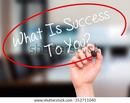 Man Hand writing What Is Success To You? with black marker on visual screen. Isolated on background. Business, technology, internet concept. Stock Photo - stock photo