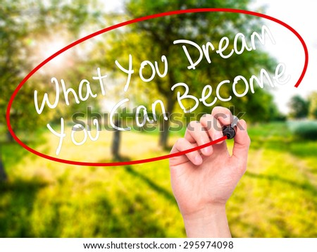 Man Hand writing What You Dream You Can Become with black marker on visual screen. Isolated on nature. Business, technology, internet concept. Stock Photo - stock photo